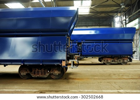 ORSOVA/ROMANIA - APRIL 25: Industry detail with two freight wagons on the factory production line in Orsova, on April 25, 2014 in Romania. - stock photo