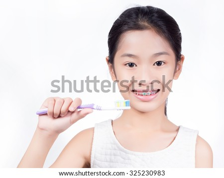 Ortho kid smile with toothbrush isolated on white background