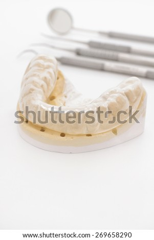Orthodontic or maxillary cast with a silicone rubber bruxism or night guard used in dentistry to prevent teeth grinding  - stock photo