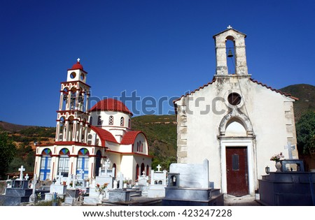 Orthodox chapel, cemetery and church on the island of Crete - stock photo
