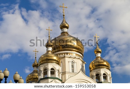 Orthodox church against the blue sky and white clouds - stock photo