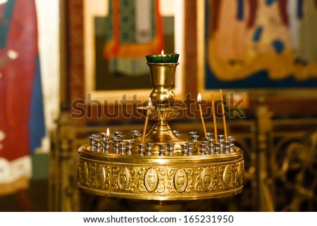 Orthodox Church and the interior, a cross and candles during worship - stock photo