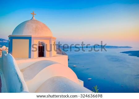 Orthodox Church building on Santorini island at evening, Greece - stock photo