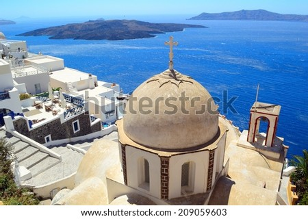 Orthodox church of St. John The Baptist at Fira, Santorini and view upon volcanic caldera