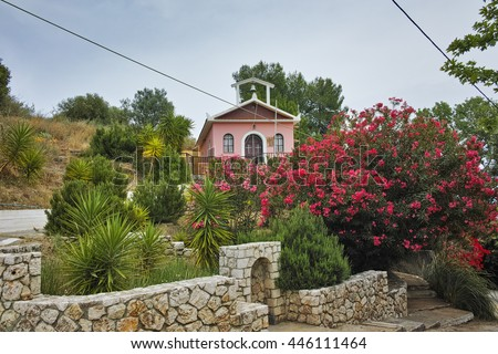 Orthodox church with spring flowers, Kefalonia, Ionian islands, Greece - stock photo