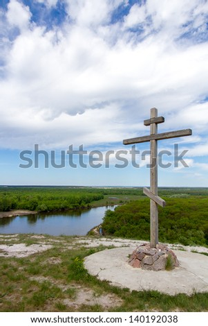 Orthodox crest over river