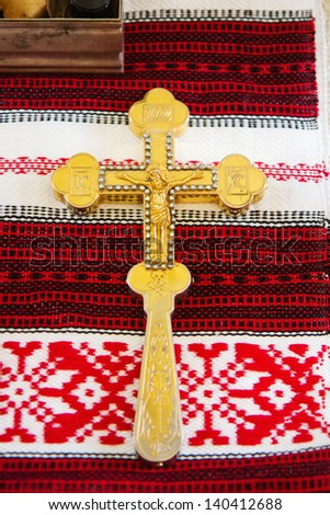 Orthodox cross prepared for ceremony in russian church - stock photo