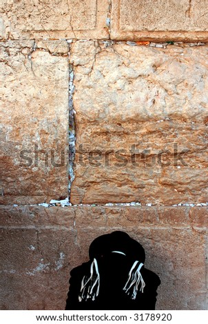 orthodox Jew prays at the western wall #4 - stock photo