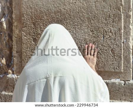 Orthodox Jewish man pray at the Wailing wall - stock photo
