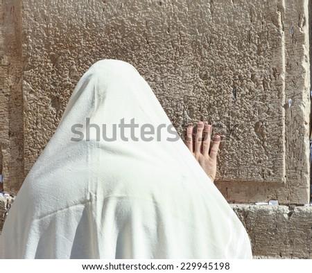 Orthodox Jewish man pray at the Wailing wall - Jerusalem - stock photo