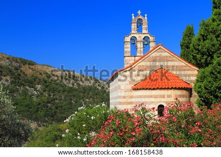 Orthodox monastery surrounded by Mediterranean vegetation - stock photo