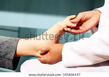 Orthopedic doctor in his office checking feet