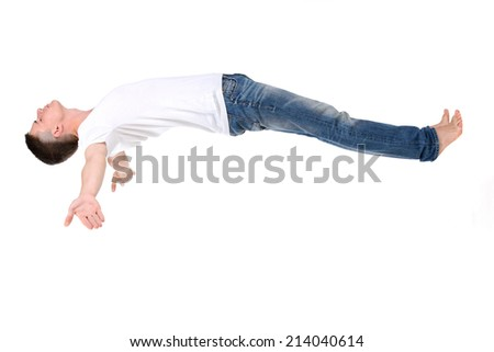 Orthopedic mattress. A young man sleeping on a mattress, side view. Flying during sleep Isolated on white background - stock photo