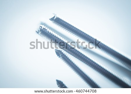 Orthopedics and Traumatology surgery plate & screws surgical titanium metal implant close-up isolated.