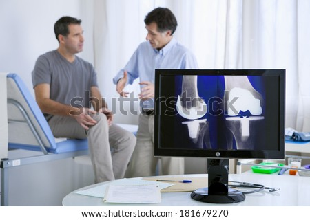 Orthopedics Consultation Man - stock photo