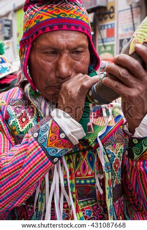Oruro, Bolivia, January, 2008: a man is playing with a horn on the street during the festivities of the Carnival of Oruro - stock photo