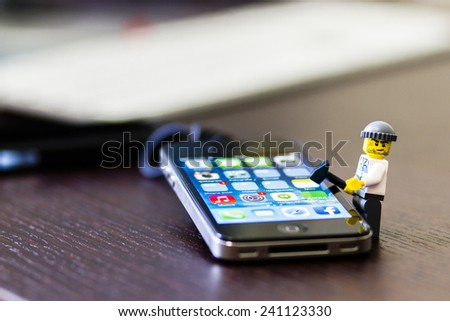 Orvieto, Italy - December 27th 2014: Lego mini figure thief on iPhone. Lego is a popular line of construction toys manufactured by the Lego Group