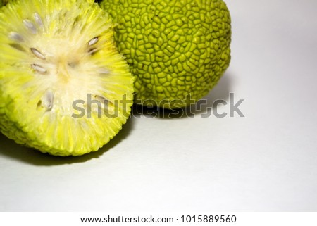 Osage Oranges (Maclura) isolated on white. Cut in half.