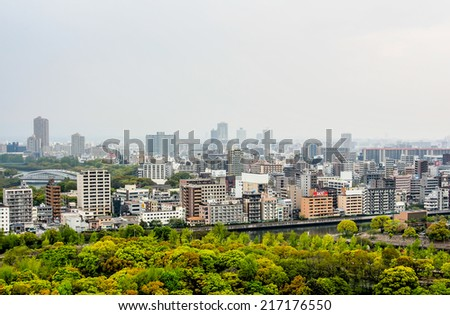 OSAKA-APR 18: Landscape of Osaka city from the top of Osaka castle in Osaka Japan on April 18, 2014. Osaka is Japan's third largest city by population after the Tokyo and Yokohama. - stock photo