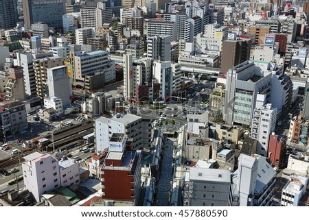 OSAKA-APR 11: Landscape of Osaka city from the top of Osaka castle in Osaka Japan on April 11, 2016. Osaka is Japan's third largest city by population after the Tokyo and Yokohama.