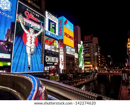 OSAKA -APR 10: The famous billboards at Dotonbori walking street in the night of Apr 10, 2013 in Osaka, Japan. Dotonbori is one of the principal tourist destinations in Osaka - stock photo