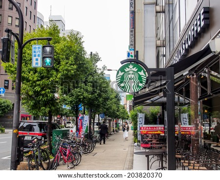 OSAKA - APRIL 20: Starbucks coffee shop in Shinsaibashi business area on April 20, 2014 in Osaka, Japan. The first store of Starbucks outside the USA or Canada opened in Tokyo, Japan in 1996 - stock photo
