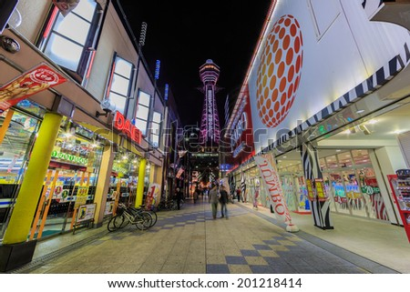 OSAKA -APRIL 7: Tsutenkaku Tower on April 7, 14 in Osaka.  It is a tower and well-known landmark of Osaka, Japan and advertises Hitachi, located in the Shinsekai district of Naniwa-ku, Osaka.
