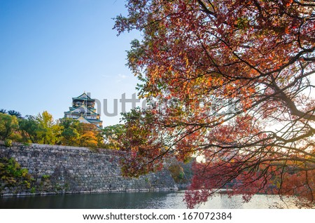 Osaka castke in Autumn on sunset clear fine day - stock photo