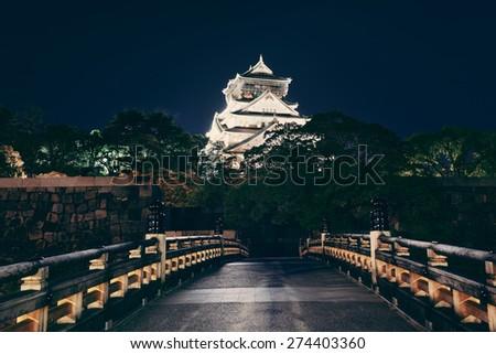 Osaka Castle at night as the famous historical landmark of the city. Japan. - stock photo