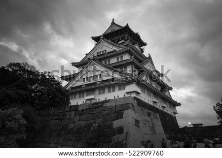 Osaka Castle at night under storm clouds, Japan.
