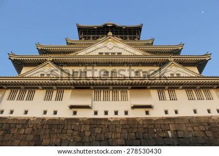 Osaka castle at sunset, Osaka Japan - stock photo
