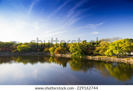 osaka Castle Park - 2014 October 29 : is a public urban park and historical site situated at Osaka, Japan. It lies on the south of the Okawa , occupies a large area in the center of the city of Osaka. - stock photo