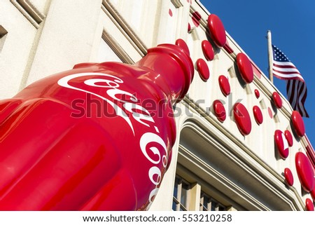 OSAKA - JAN 10: A big Coca-Cola logo on the wall and American Flag in Osaka on January 10. 2017 in Japan