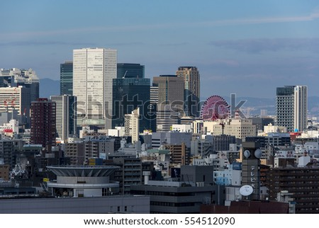 OSAKA - JAN 11: Japan city skyline, modern districts of Osaka city on January 11. 2017 in Japan