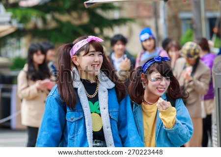 Osaka, Japan - Apr 9: View of tourists and  outside the Universal Studios Theme Park in Osaka, Japan on Apr 9, 2015. The theme park has many attractions based on the film industry. - stock photo
