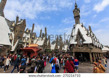Osaka, Japan - Apr 9, 2015 : Visitors enjoying the Harry Potter themed attractions and shops at the Hogsmeade Village inside Universal Studios of Adventure theme park - stock photo