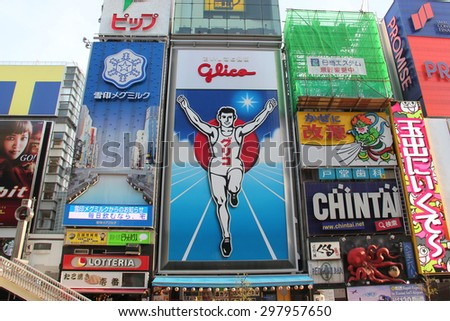 Osaka, Japan - April 8, 2015: Glico billboard is an icon of Dotonbori, a famous tourist destination for nightlife and entertainment area in Osaka, Japan.