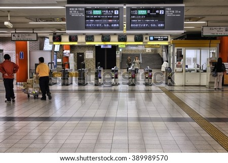 OSAKA, JAPAN - APRIL 26, 2012: Passengers walk in Osaka Namba train station in Osaka, Japan. Osaka Namba exists since 1970 and was used by average 150,000 passengers daily in 2010.