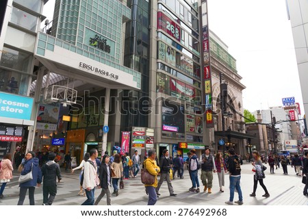 OSAKA,JAPAN - APRIL 20 : Tourists visit Dotonbori on April 20,2015 in Osaka. It is one of the tourist destinations in Osaka, Japan. It is a single street, running alongside the Dotonbori canal.