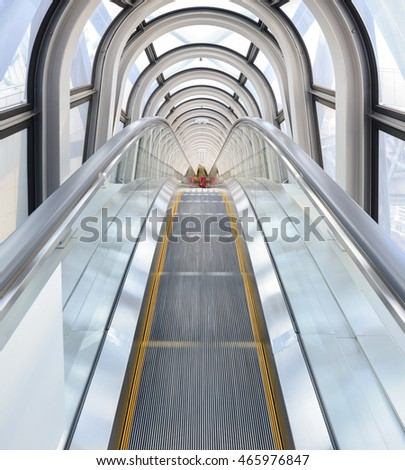 Osaka, Japan - April 08, 2015: View of the spectacular escalator in Umeda Sky Building with tourist, a modern high rise skyscraper in the Kita district of Osaka, Japan