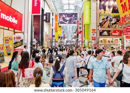 OSAKA, JAPAN - AUGUST 05:  People walking in the Dotonburi, Osaka. Dotonburi is one of the principal tourist destinations in Osaka, Japan. - stock photo