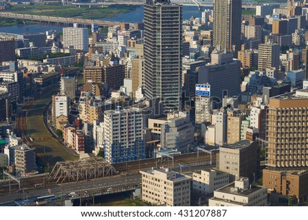 OSAKA, JAPAN - AUGUST 2015: View from the observatory viewing platform of the Umeda Sky Building in Osaka - view to a northern suburb with railway lines.