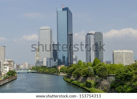 Osaka, Japan business district skyline near Kyobashi.