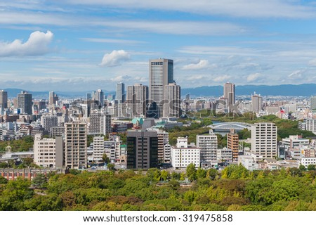 OSAKA, JAPAN --10 DEC  2014-- The city of Osaka, in the Kansai region and Osaka prefecture, is the second largest metropolitan area in Japan. Downtown Osaka is very modern with many skyscrapers. - stock photo