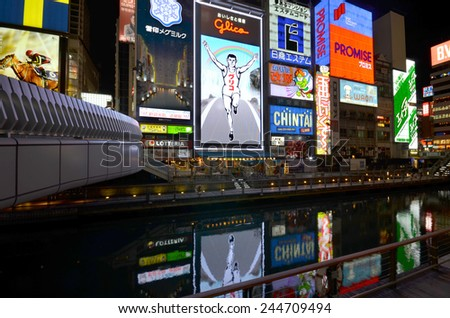OSAKA, JAPAN - DEC 04 2014: The Glico Man light billboard and other light displays on December 04, 2014 in Dontonbori, Osaka, Japan. Namba is well known as an entertainment area in Osaka.