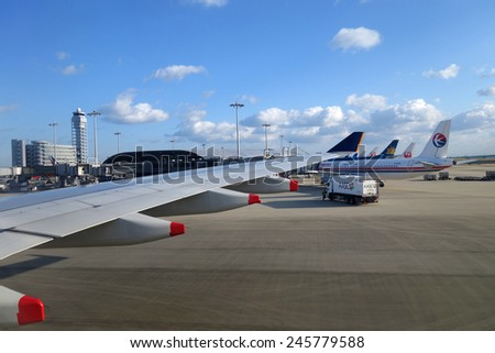OSAKA, JAPAN - DEC 08: Various airplanes park in Kansai Airportin Osaka, Japan on December 08, 2014. Kansai airport is built in the man-made island in the sea. - stock photo