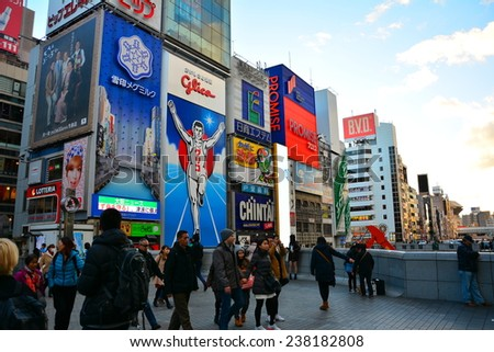 OSAKA, JAPAN - 9 December 2014 : Dotonbori street in Osaka. One of the famous tourist spots in Osaka. People come to see the mascot of Glico which already changed in this year - stock photo