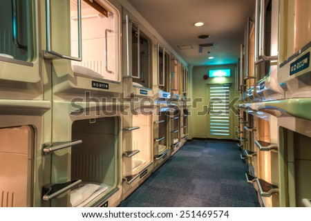 OSAKA, JAPAN - DECEMBER 27: Interior of a capsule hotel. Photo taken December 27, 2014 in Osaka, Japan. - stock photo