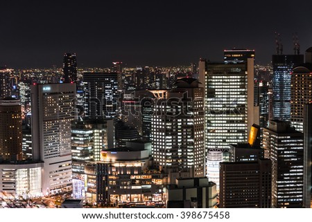 Osaka, Japan - Feb.20, 2016:Cityscape of Osaka at night. Night view of buildings and towers in Osaka.