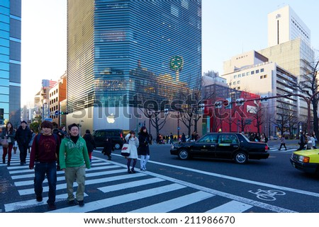 Osaka, Japan - February 23, 2014: Shoppers and tourists past by a large Apple Store from tilt-shift lens on February 23, 2014 in Shinsaibashi, Osaka, Japan. - stock photo